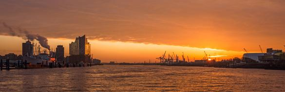 Hamburg port panorama against golden sunset