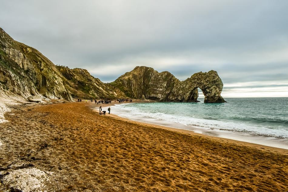 Durdle Door, scenic rock formation in sea at coast, view from Beach, uk, england, Dorset
