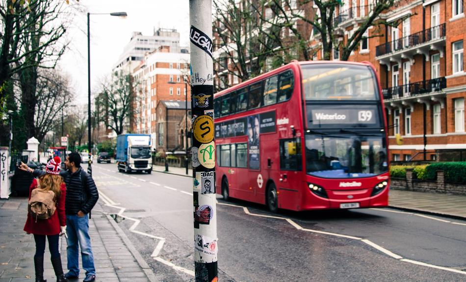 red bus on london city street