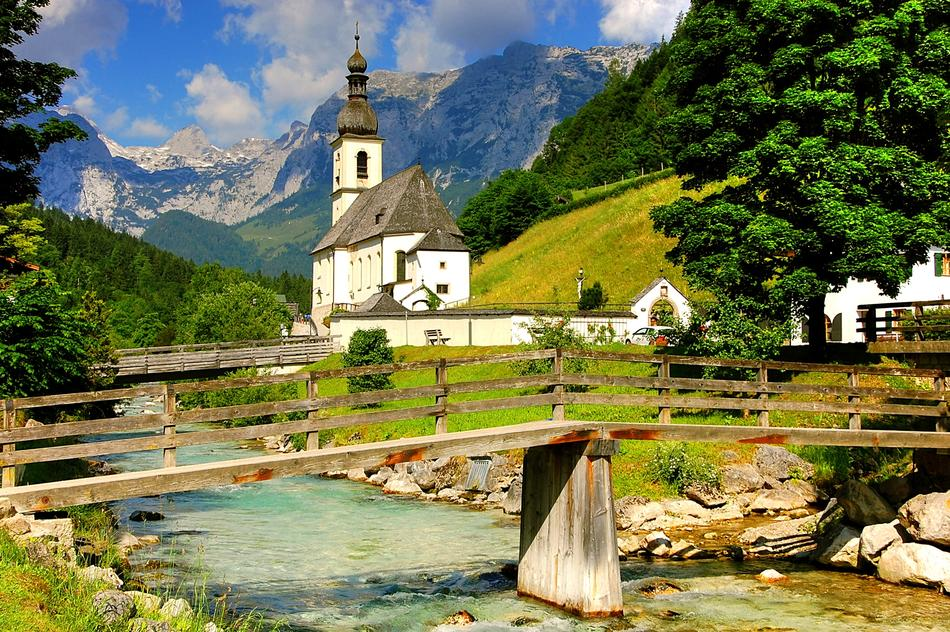 pedestrian bridge across stream in front of Ramsau Church, scenic landscape, germany, berchtesgaden national park