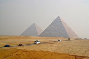 Pyramids Egypt Sand and cars