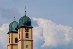 two Steeples of Baroque Church at cloudy sky