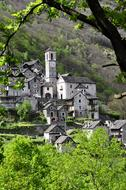 photo of stone buildings at the foot of a mountain in Ticino, Switzerland
