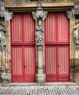 red church doors with portal
