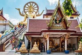 beautiful temple and golden buddha statue on Koh Samui, Thailand