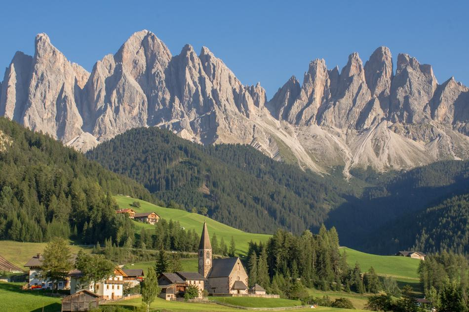 distant view of a chapel in the mountains of south tyrol