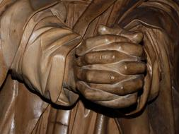 Prayer hands statue