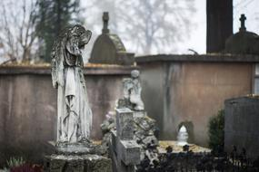Old statues with angel on the cemetery