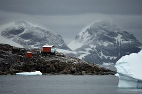 scientific base on the background of glaciers in Antarctica