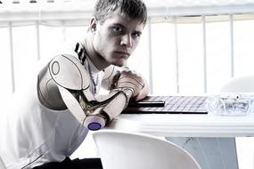 portrait of a young man with a robot arm