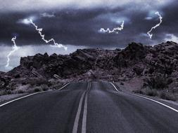 highway in Utah amid lightning and stormy sky