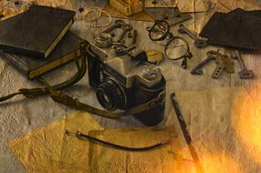 photomontage, old camera, glasses, keys and diaries