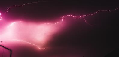 lightning in the pink night sky