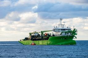 green Dredging Ship in sea