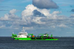 green cargo ship on the north sea