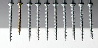 one coated screw among uncoated ones