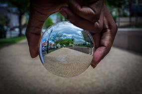 reflection in a glass ball in hand