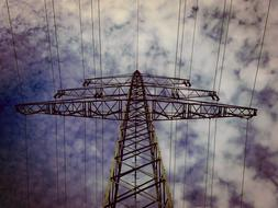 high-voltage tower against a cloudy sky