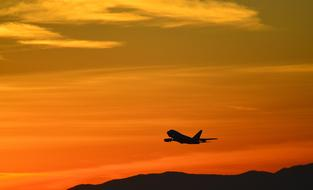 red Sunset Airplane Silhouette