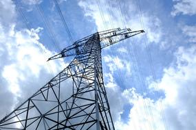 Electric Pylon Current and cloudy blue sky