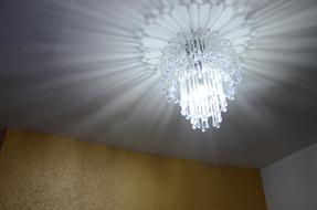 light of crystal chandelier in the room