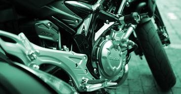 Silver Suzuki motorcycle on the photo in green effect