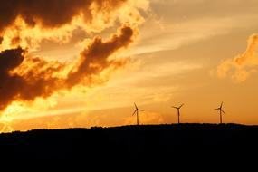 wind turbines against a clear evening sky