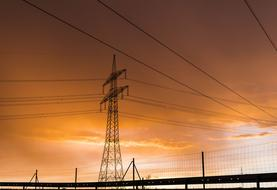 Current Electricity Strommast and orange sky