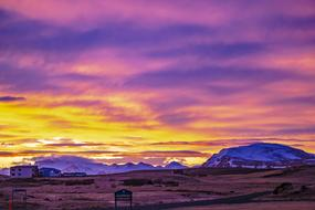 colorful Sunrise sky above small town, Iceland, Hellissandur
