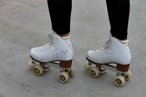 four wheeled retro rollers on the legs of a girl