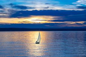 sailing boat on Lake Constance at sunset