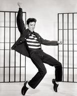 black and white photo of dancing Elvis Presley