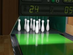white skittles on a green track in bowling