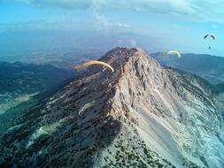 parachute flying over a mountain range