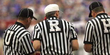three Football Referees