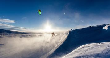 snow kiting in sunny day