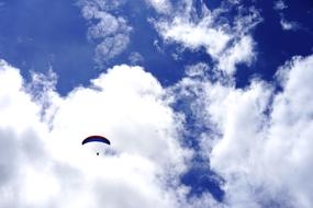 Paraglider high at sky