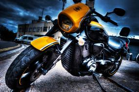 black and yellow Motorbike parked at building