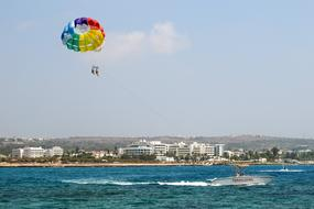 parachute flying over the beach in Ayia Napa, Cyprus