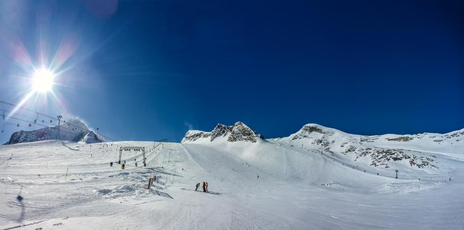 skiers and ski lift at snowy Kitzsteinhorn, panoramic view