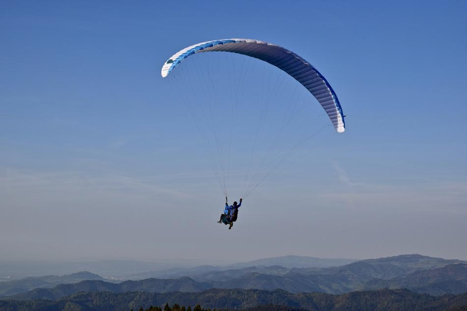 Paragliding, Glider at Sky above green mountains at dusk