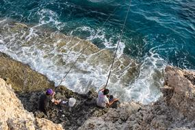 two fishermen by the sea in Ayia Napa, Cyprus