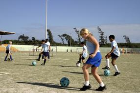 girls and boys in soccer practice