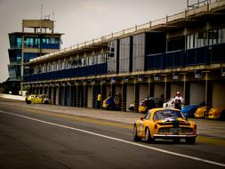vintage yellow racing car on the track