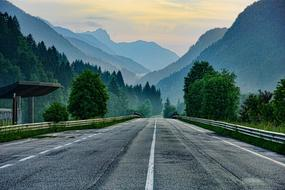 evening photo of highway on a background of foggy mountains