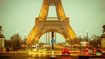 photo of car traffic under the Eiffel Tower