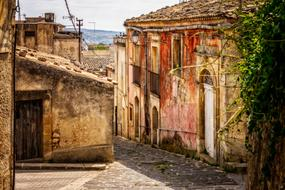 grunge old houses on alley in Village, italy, Sicily