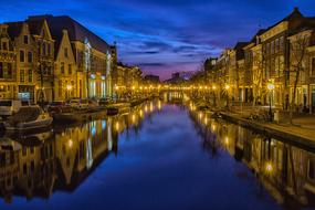 night photo of buildings on the canal in Holland
