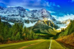 Panorama of road and snowy mountains in Banff National Park, Canada