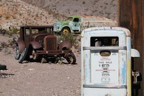 Old lapsed Cars near Rusty fuel pump, Usa, nevada, nelson